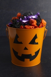 Pumpkin Bucket Filled With Various Wrapped Candies